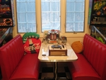 BOOTH IN OUR 50-60S ROOM WITH CANDY RECORD PLAYER CAKE